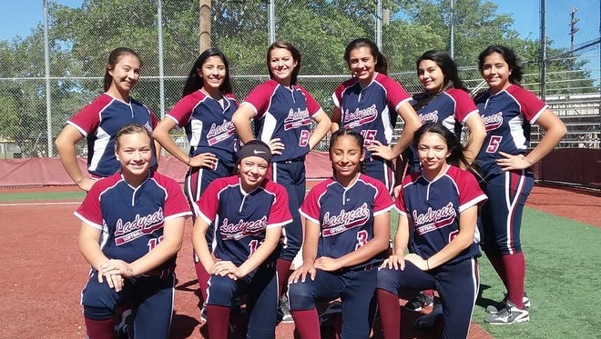 The Deming High Junior Varsity Lady Cat Softball Team placed second in the District 3-5A standings behind Alamogordo High School. The team capped an impressive 18-8-1 season under Head Coach Oscar Jurado. Standing, from left, are Kaydance Chavez, Janae Jasso, Kaitlyn Morgan, Yesenia Flores, Valerie Munoz and Aileen Jacquez. Kneeling, from left, Palmira Valentine, Pilar Garcia, Jasmine Lopez and Alexis Trejo. Not pictured are Chloe Martinez and Yeimi Bustos.