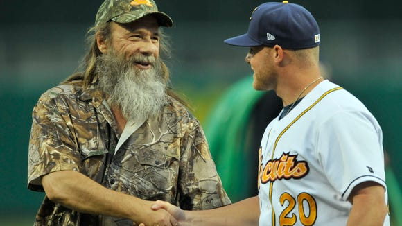 Tim Guraedy, Duck Dynasty's Mountain Man, shakes hands with Montgomery Biscuits' Matt Ramsey (20) before their game with Mississippi Braves at Riverwalk Stadium on Saturday, May 31, 2014.