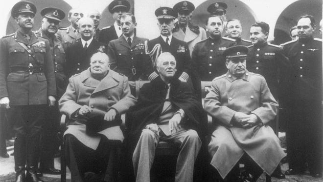Participants in the Big Three Conference on February 12, 1945. Seated, (l to r) British Prime Minister Winston Churchill, U.S. President Franklin D. Roosevelt and Soviet Premier Josef Stalin.