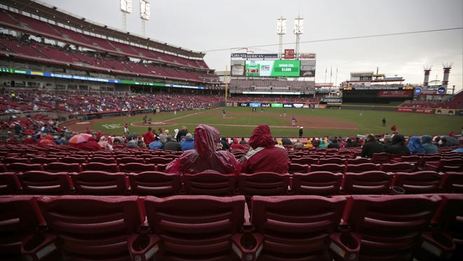 Thousands of seats remain empty as play carries on through light rain during the first inning of the MLB game between the Cincinnati Reds and the Chicago Cubs - the final game of the season at Great American Ball Park in Cincinnati on Thursday, Oct. 1, 2015. The 2015 season suffered from more than 57 hours of rain delays over 81 home games.