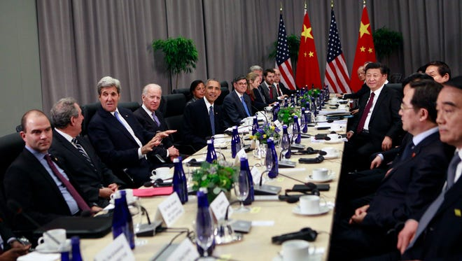 President Obama, China President Xi Jinping, and U.S. and Chinese officials during a meeting Thursday in Washington, D.C.