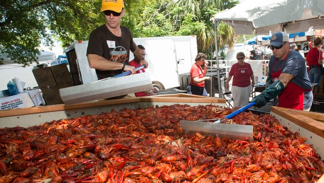 Jay Boatwright, left, and David Harrison, prepare a hot batch of boiled crawfish for the lunch crowd at a past Pensacola Crawfish Festival. The festival returns to downtown Pensacola Friday.