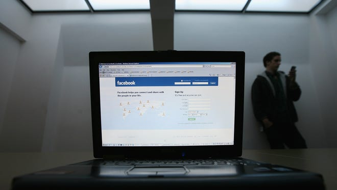 In this photo illustration, Facebook is displayed on a laptop screen. The U.S. government is considering asking non-U.S. travelers for their social media handles as it seeks to combat terrorists' use of social media for recruitment and coordination.