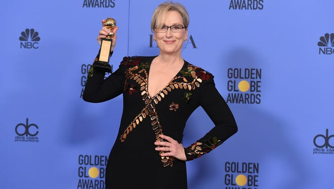 Meryl Streep poses in the press room with the Cecil B. DeMille Award at the 74th annual Golden Globe Awards at the Beverly Hilton Hotel on Jan. 8, 2017, in Beverly Hills, Calif.