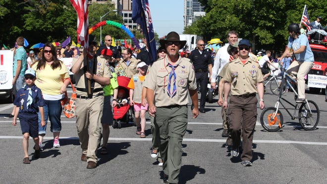 Boy Scouts are shown marching in the Utah Gay Pride Parade on June 2, 2013, in Salt Lake City. Members of Scouts for Equality marched in the parade after a vote by Boy Scouts of America to allow openly gay youths to participate in scouting.