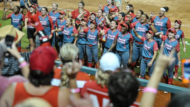 Louisiana Softball cheer on their fans after beating LSU in the NCAA Regional Tournament.. Saturday, May 20, 2017.
