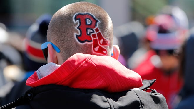 A Red Sox fan gets ready to file in to the game's 2018 home opener.