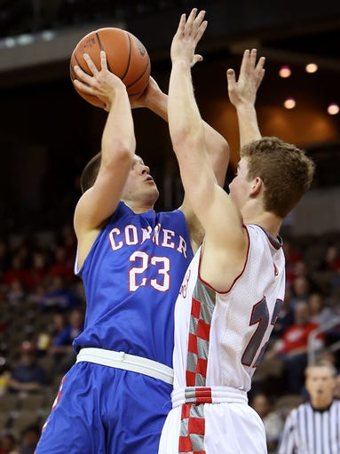 Conner's Will Ruholt (23) shoots against Adam Daria (12).