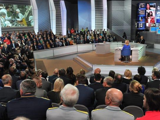 Russian President Vladimir Putin takes questions April