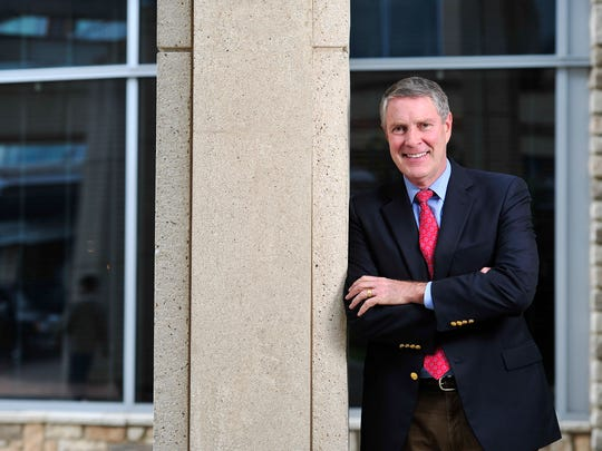 Former U.S. Senator Bill Frist, who will lead new health care technology company CareBridge, poses for a portrait outside a West End office building in this Tennessean file photo.