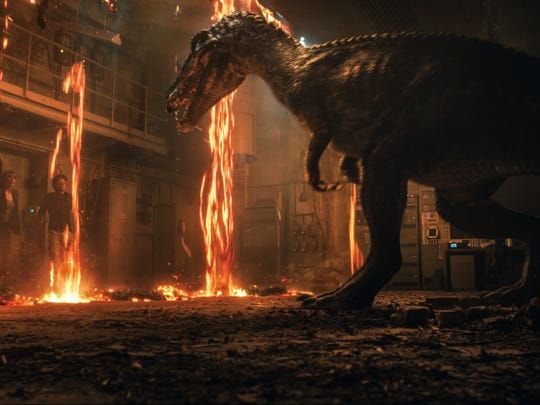 "Claire (BRYCE DALLAS HOWARD) and Franklin (JUSTICE SMITH) encounter the Baryonyx in ""Jurassic World: Fallen Kingdom.""  When the island's dormant volcano begins roaring to life, Owen (CHRIS PRATT) and Claire mount a campaign to rescue the remaining dinosaurs from this extinction-level event.  Welcome to ""Jurassic World: Fallen Kingdom."""