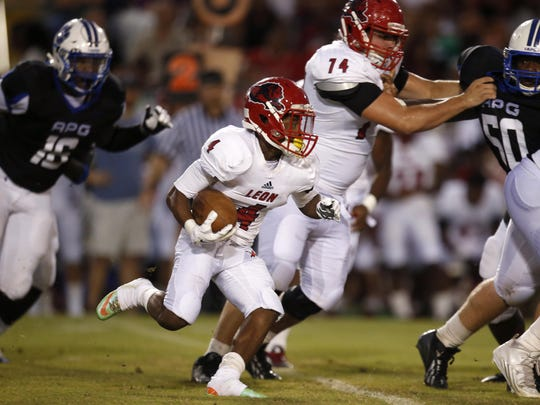 Leon's Darqueze Brutton runs the ball against Godby during their game at Cox Stadium on Friday. The Lions play at Florida High this week.
