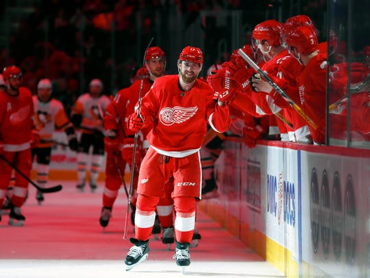 Detroit Red Wings defenseman Filip Hronek celebrates his goal against the Pittsburgh Penguins in the third period of an NHL hockey game Saturday, Dec. 7, 2019, in Detroit. (AP Photo/Paul Sancya)