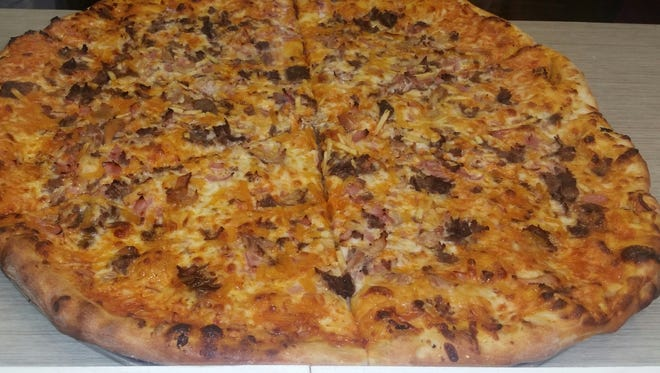 Bomberos Tripleta Pizza is topped with ham, chicken, steak, potato sticks and a mayo/ketchup sauce.