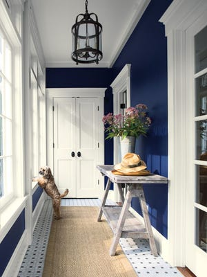 A simple and stylish hallway bursts with the depth and purity of blue and white, a promise of great things to come.