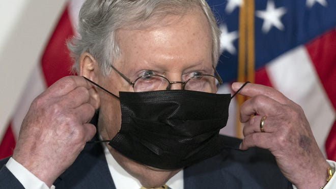 Senate Majority Leader Mitch McConnell of Ky., puts his face mask back on after speaking during a news conference of Senate Republican leadership, Wednesday, Sept. 9, 2020, on Capitol Hill in Washington.