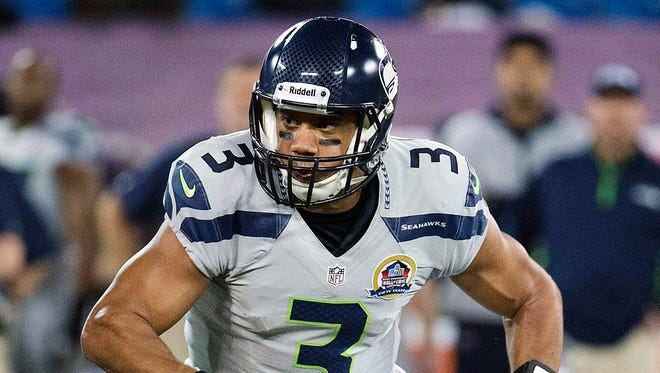 """Russell Wilson and the Seattle Seahawks ran Auburn's """"pop pass"""" play against the Green Bay Packers."""