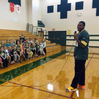 Green Bay Packers player Jayrone Elliott speaks to students Tuesday October 13, 2015 at St. John the Baptist in Plymouth.  He answered questions about being a Packer and stressed to the children to work hard in their studies.