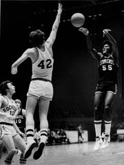 Syracuse's Chris Sease shoots over University of Rochester's Mike O'Brien in a 1974 Kodak Classic game.