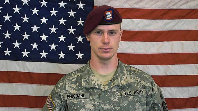 UNDATED - In this undated image provided by the U.S. Army, Sgt. Bowe Bergdahl poses in front of an American flag. U.S. officials say Bergdahl, the only American soldier held prisoner in Afghanistan, was exchanged for five Taliban commanders being held at Guantanamo Bay, Cuba, according to published reports. Bergdahl is in stable condition at a Berlin hospital, according to the reports.  (Photo by U.S. Army via Getty Images) ORG XMIT: 459829471 ORIG FILE ID: 495330957
