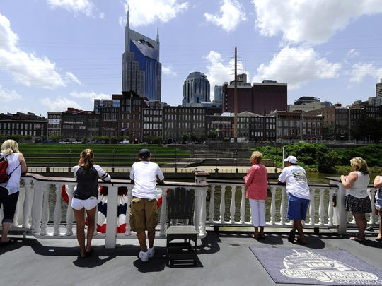 Passengers enjoy a view of the Nashville skyline as their cruise the Cumberland River aboard the General Jackson riverboat Friday July 10, 2015, in Nashville, Tenn.