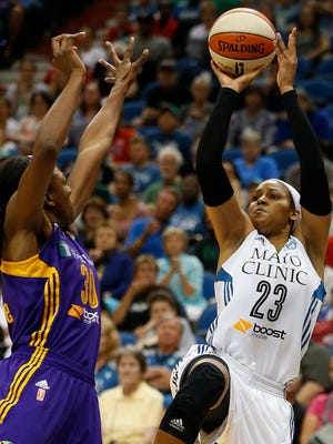 Minnesota Lynx forward Maya Moore shoots against Los Angeles Sparks forward Nneka Ogwumike (30) during the first half of a WNBA basketball game,