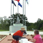 St. Landry Parish Veterans Memorial volunteers place memorial bricks.  Freddie Herpin, Daily World
