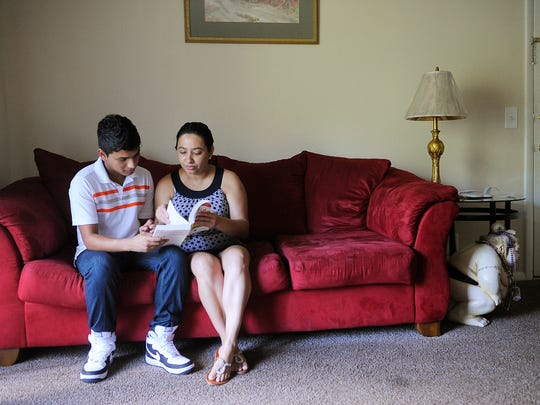 Gerardo Rodriguez sits with his aunt Dania Cruz as she tries to teach him English in her Nashville apartment.