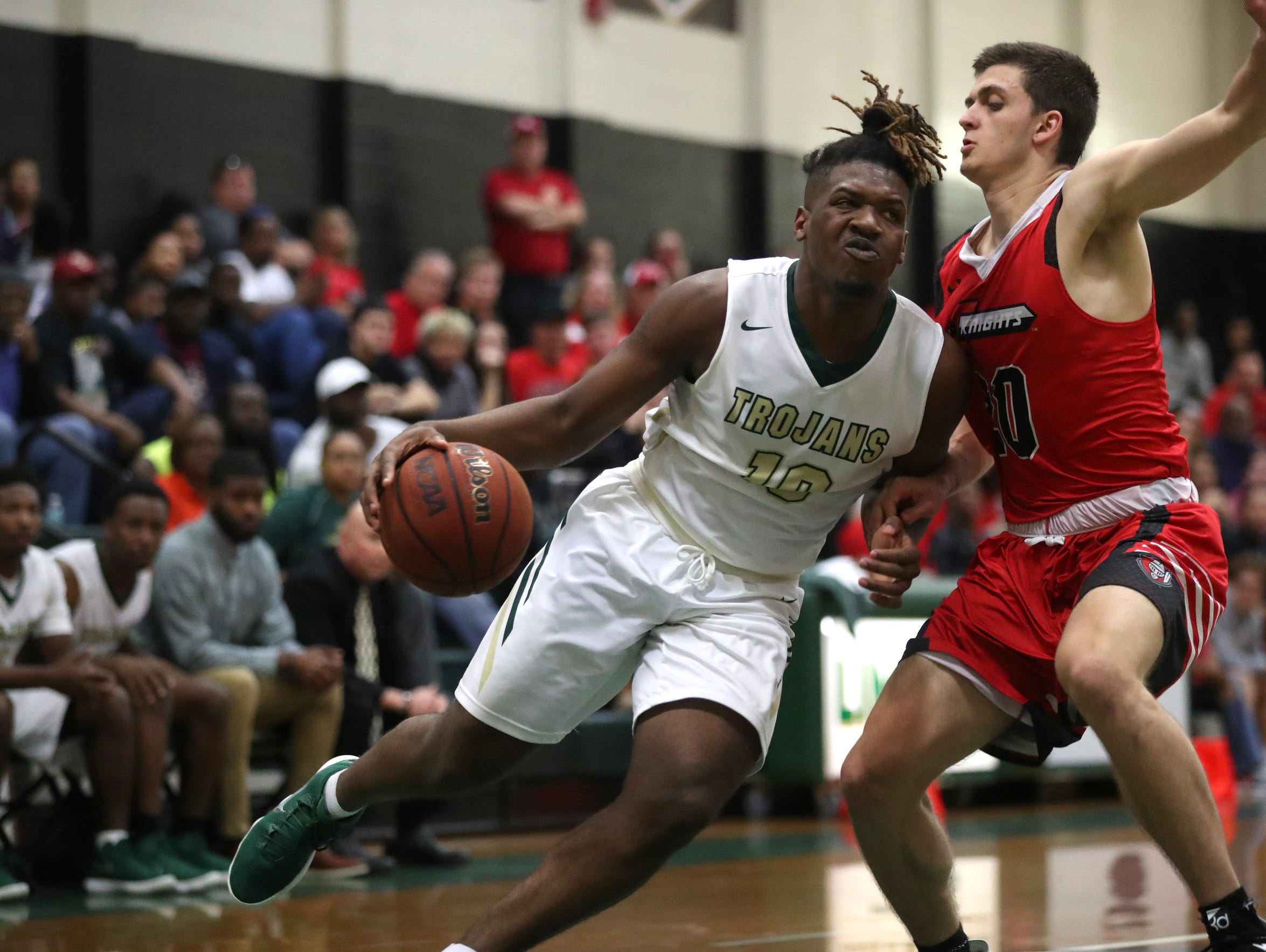 Lincoln's Tyler Farmer tries to drive past Creekside's