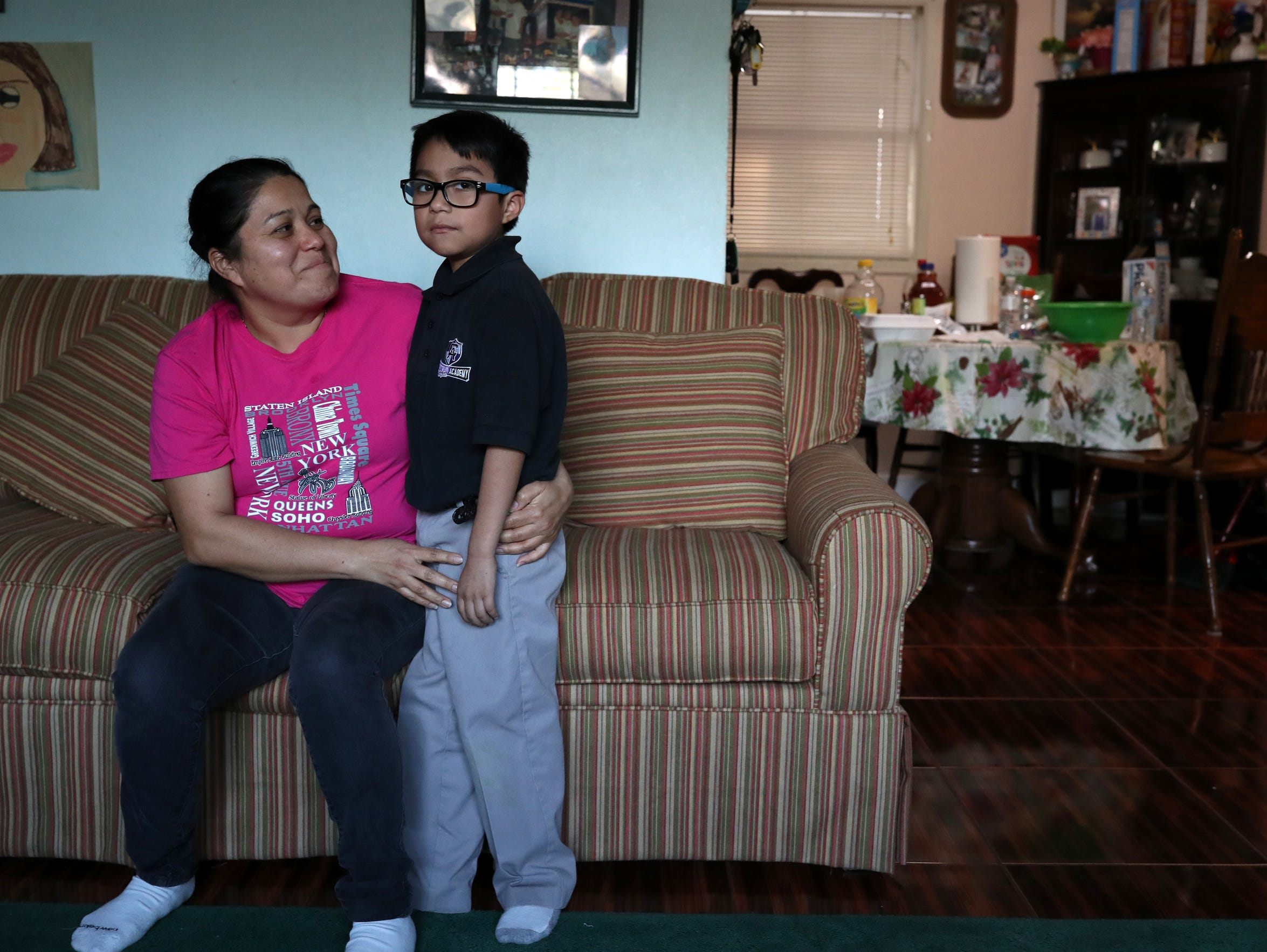 Gladis de la Cruz with her son Eric, 8, at their Quincy home on Thursday, Feb. 15, 2018. Cruz is Salvadoran moved to the U.S. in the 1990's and has three children who are all American citizens.