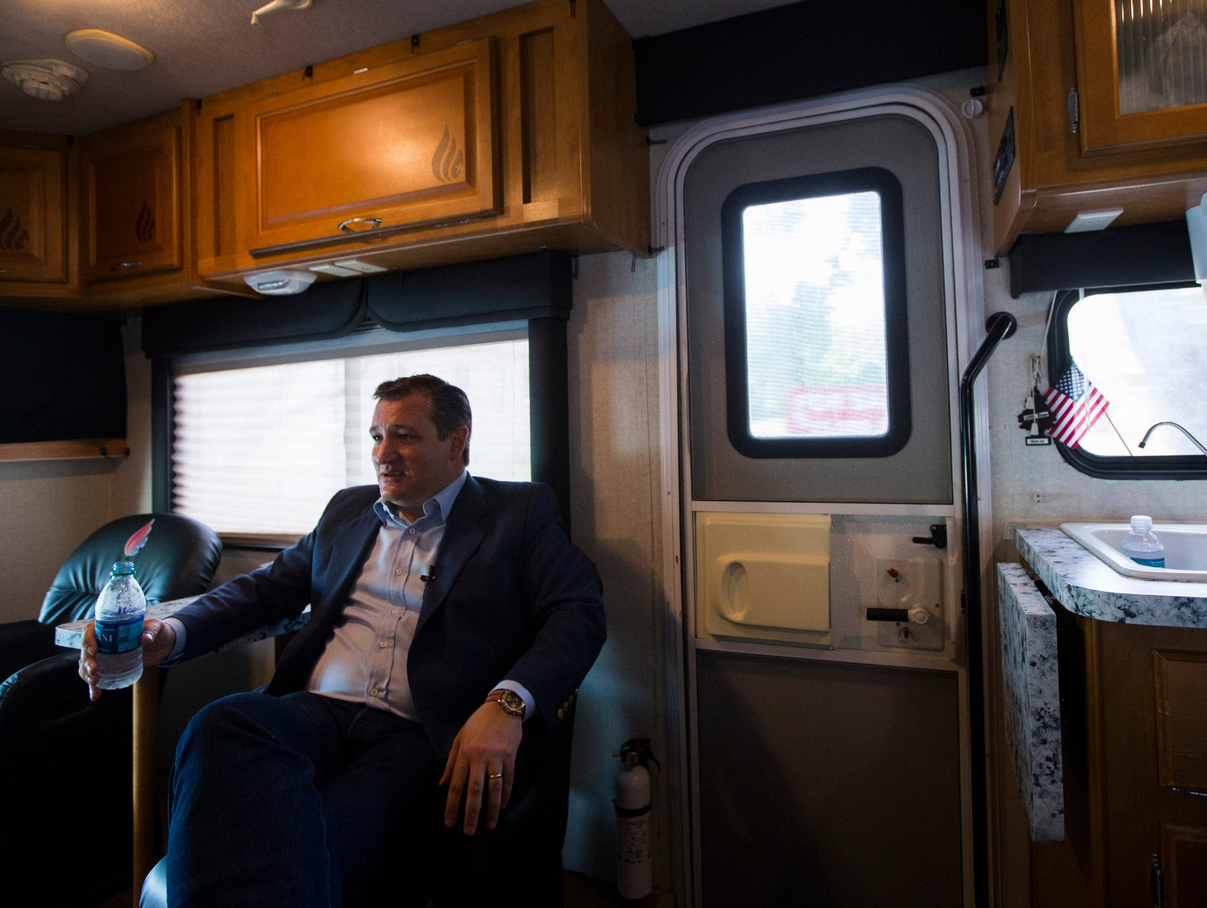 U.S. Sen. Ted Cruz rides in his campaign bus following