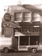 An old exterior of House of Pizza.