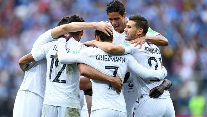 French players celebrate a goal by Antoine Griezmann (7) during a World Cup quarterfinal win Thursday over Uruguay. France will face Belgium in a semifinal game at noon Tuesday on FOX.