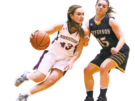 Morristown's Elizabeth Strambi tries to move pass Jefferson's Ashley Hutchinson during the first half of the Morris County Tournament girls basketball championship game at County College of Morris in Randolph on Friday.