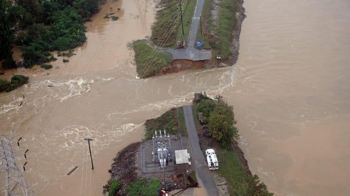 Heavy rains, flooding batter East Coast