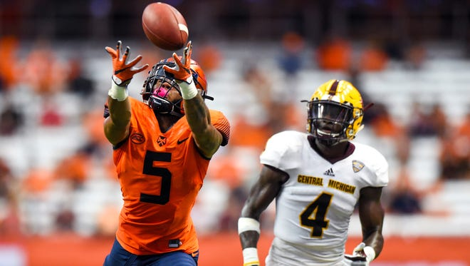 Syracuse wide receiver Devin C. Butler (eaches for a pass in front of Central Michigan's  Darwyn Kelly during the fourth quarter at the Carrier Dome.