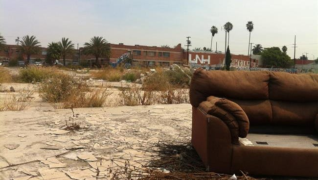 Many vacant lots are strewn with trash and old furniture.