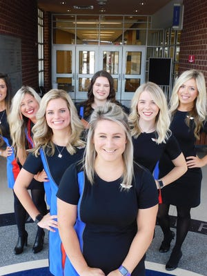 These Southwest Airlines flight attendants all share the same alma mater -- Midlothian High School. Front row, Lauren Edwards, second row, Katie Roberts and Haley Thorne, back row, Faith Roberts, Heather Blackwell, Kelcey Ellis and Lindsey Goss. Not pictured in this photo are Dana Sorrels of Flower Mound and Maggie Bowman of Nashville, Tennessee.