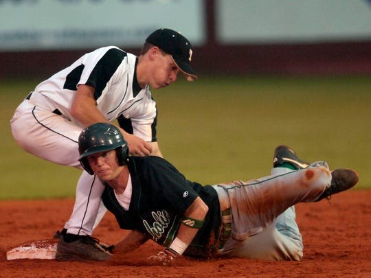 Pensacola Catholic's Seth Currie attempts to steal