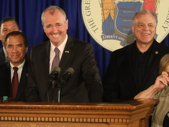 Assembly Majority Leader, Louis Greenwald, Assembly Speaker Craig Coughlin, Governor Phil Murphy and Senator Loretta Weinberg at the announcement of a budget deal.