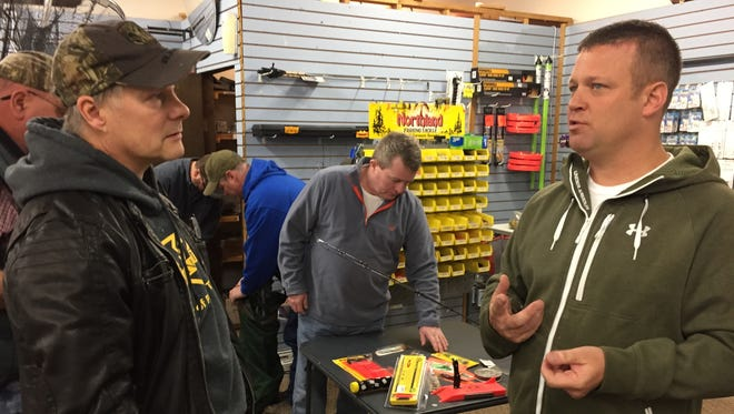 """Fisherman Dave Page, left, speaks with Ralph Kinsley during """"Fish Church"""" at Anderson's Pro Bait. Kinsley spoke about salmon and trout fishing."""