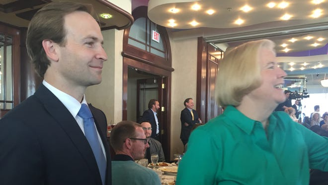 Lt. Gov. Brian Calley and Macomb County Public Works Director Candice Miller make the rounds at a Macomb County Chamber of Commerce luncheon on Monday.