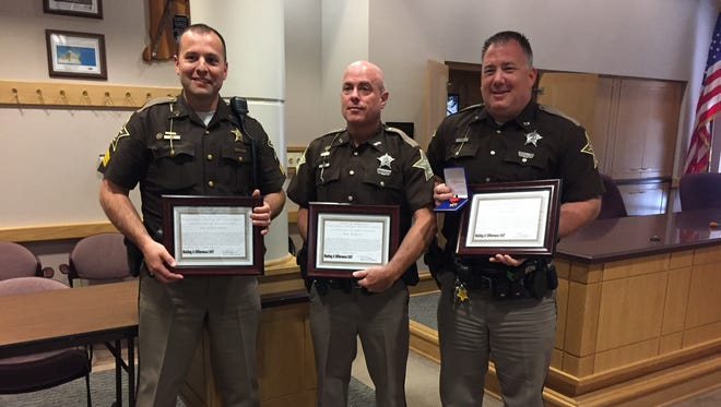 Sgt. Jon Lendermon (left) and deputies Rob Reppert (center) and Rob Rush were recognized Tuesday, May 23, 2017, after they rescued two women from Wildcat Creek.