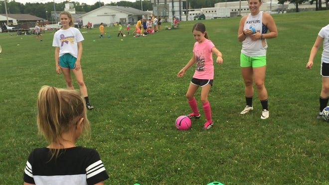 Third-grader Sofia Ciraky practices a passing drill July 11 during the Watkins Memorial girls soccer team's youth camp.