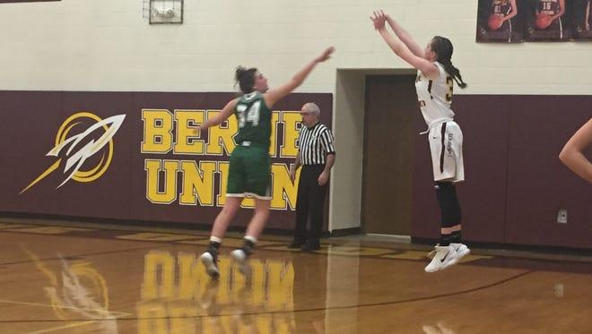 Berne Union freshman Bella Kline shoots a 3-pointer over Fisher Catholic's Emma Burley on Wednesday. Rockets won 43-31.