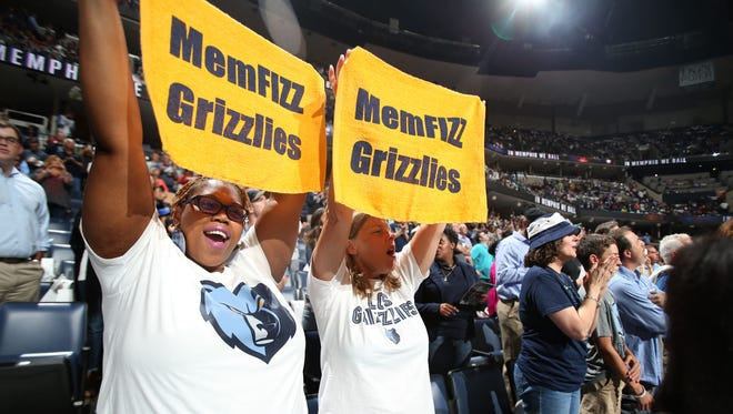 Memphis Grizzlies fans Roshanda Coleman and Carol Jackson cheer on their team for the home opener against the Minnesota Timberwolves.