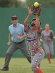 Sienna Condash (20) makes the catch and the batter