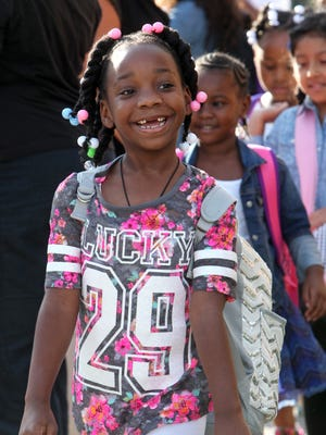 Ninshakhar'ra El was all smiles as she lined up for the first day of school last year at Post Road School in White Plains.