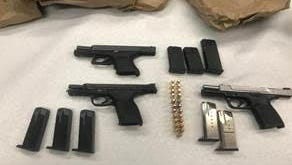 Oxnard police confiscated three handguns during a search warrant served early Wednesday morning.