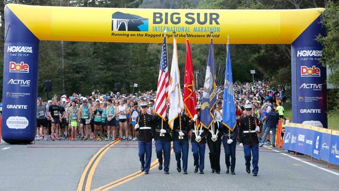 Armed Forces color guards walk off as the 33rd annual Big Sur International Marathon gets underway on Sunday, April 29, 2018 in Big Sur, Calif.